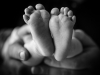newborn baby portrait showing tiny feet